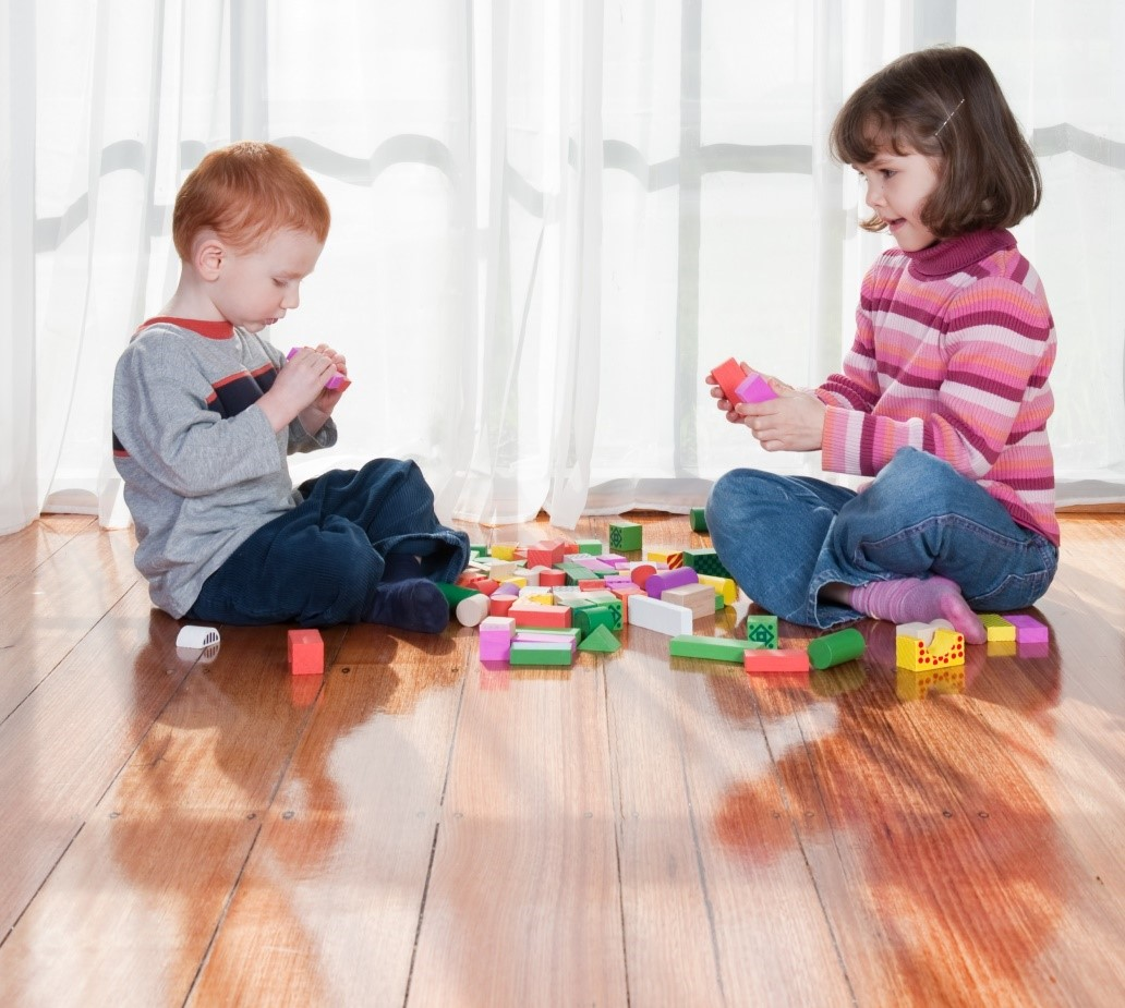 kids playing on hardwood flooring